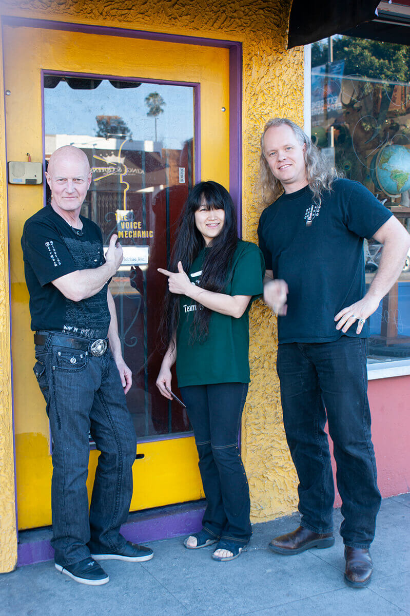 Sean Lee with Chris Slade of AC/DC and Miwa outside the front door of the first Voice Mechanic location on Melrose Ave in Los Angeles.